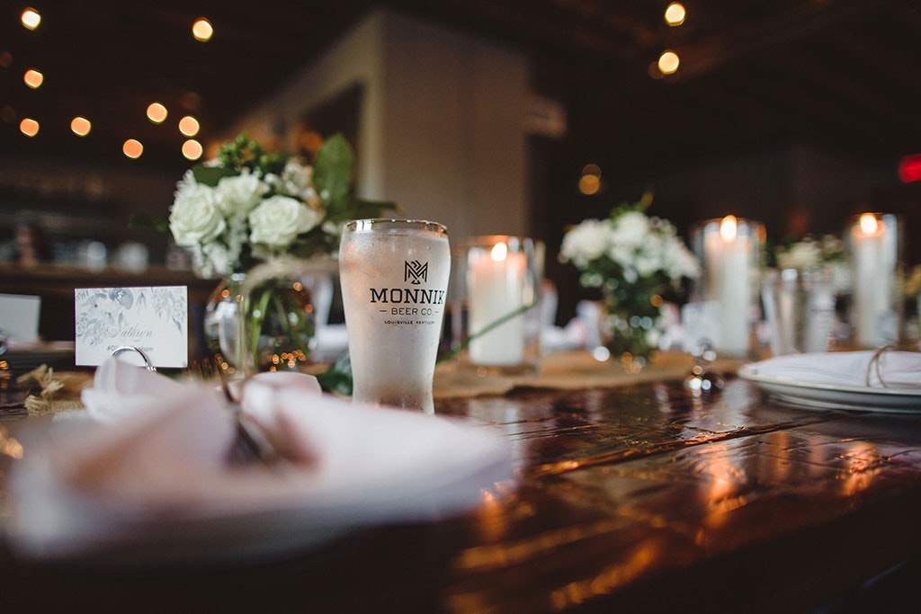 fancy dinner table setting with Monnik beer glass in focus