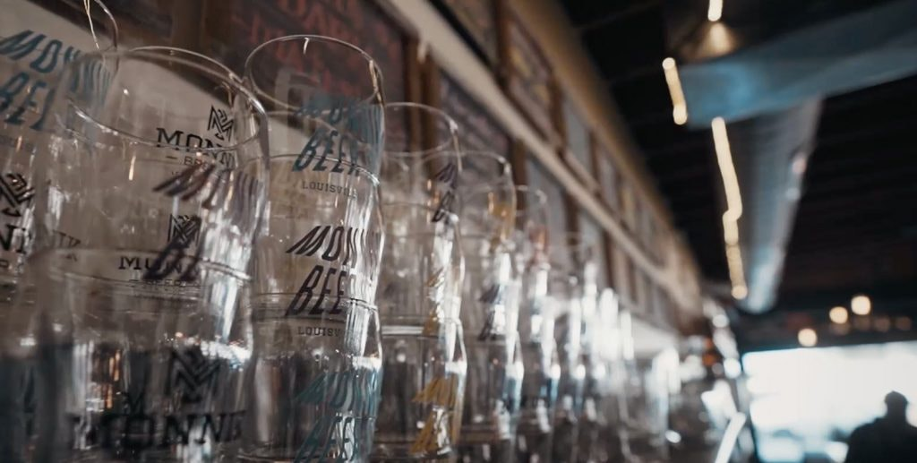 row of stacked Monnik beer glasses